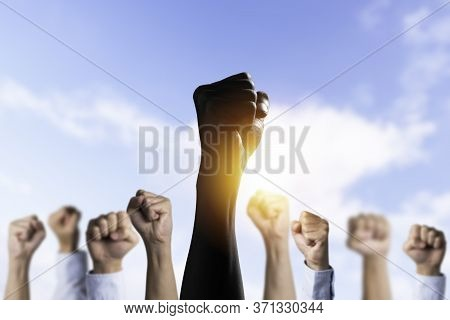 Black People Raise Their Hands Among The White Hands To Protest In The United States. About Racism A