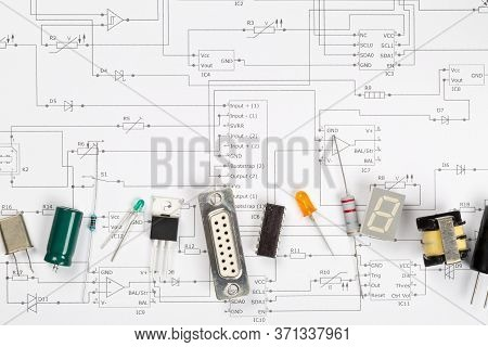 Different Electronic Parts Or Components On Pcb Wiring Scheme Background With Resistors, Capacitors,