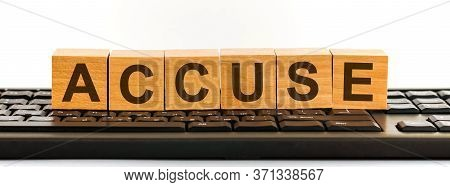 Accuse Word Made With Building Blocks. A Row Of Wooden Cubes With A Word Written In Black Font Is Lo