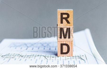 Wooden Block With Words Rmd - Acronim Rmd - Required Minimum Distributions. Concept Image Of Account