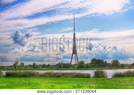 View Of Riga Radio And Tv Tower And Cloudy Sky In Riga, Latvia. It Is The Tallest Tower In The Europ
