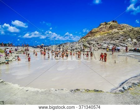 Vulcano, Italy - July 16, 2014: Unidentified People Having A Mud And Sulfur Bath On The Volcanic Isl