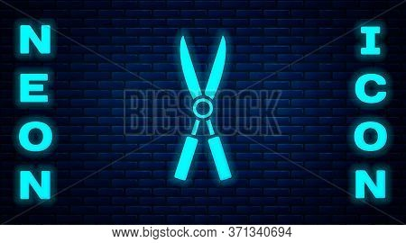 Glowing Neon Gardening Handmade Scissors For Trimming Icon Isolated On Brick Wall Background. Prunin