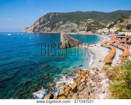 Monterosso Al Mare, Italy - July 28, 2016: Panoramic Summer View Of The Beach In Monterosso, Cinque