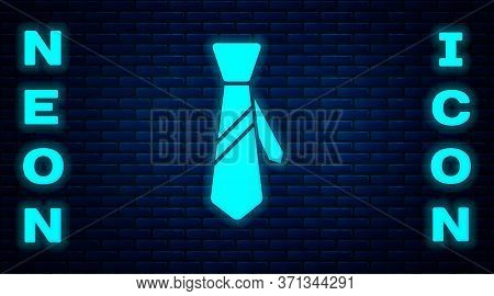 Glowing Neon Tie Icon Isolated On Brick Wall Background. Necktie And Neckcloth Symbol. Vector Illust