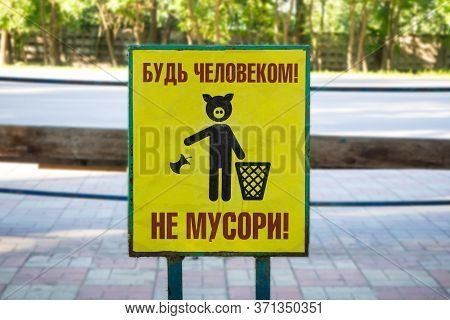 Garbage Icon Symbol. Do Not Litter Sign. A Warning Sign At A Bus Stop Near Park With A Pig And Russi