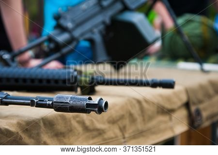 Machine Guns With Ammunition On The Table