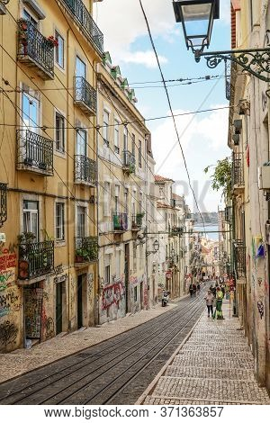 Lisbon, Portugal - July 4, 2019: The Street On Which Runs Elevador Or Ascensor Da Bica, Is A Popular