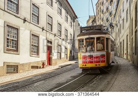 Lisbon, Portugal - July 4, 2019: Famous Tram 28 Full Of Tourists In The City Center Of Lisbon - One