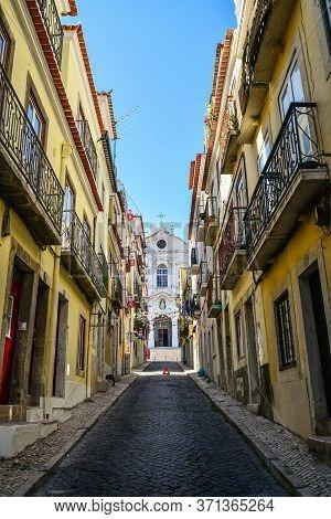 Lisbon, Portugal - July 4, 2019: Narrow Cobblestone Streets Of The Chiado District In Lisbon, Portug