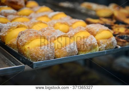 Pile Of Traditional Portuguese Pastries On Sale In A Lisbon Bakery Closeup