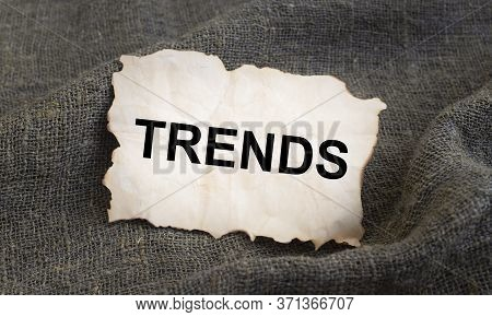 Trends Word Inscription On Craft Paper On Natural Linen Cloth. Cloth Trends. Fashion Trends. Natural