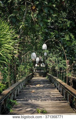 Old Wooden Bridge In Ubud, Bali. Tropical Travel In Indonesia.