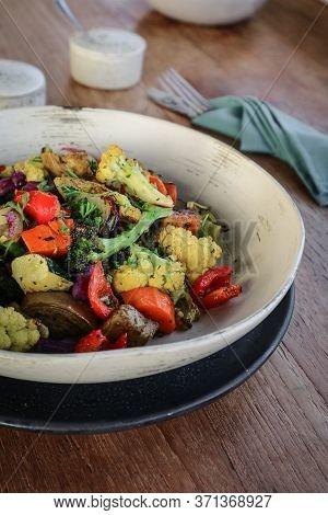 Oven Baked Vegetables - Broccoli, Pumpkin, Cauliflower And Zuccini - In Bowl On Wooden Background