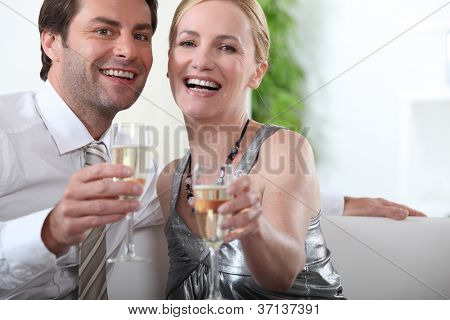 Couple sitting with arms stretched