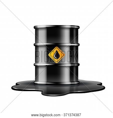 Black Barrel With Oil Drop Label On Spilled Puddle Of Crude Oil.