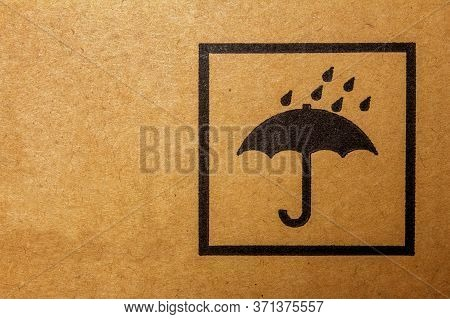 Packaging Sign Usually Found On Cargo Packages. It Means To Keep The Package Away From Rain Or Damp