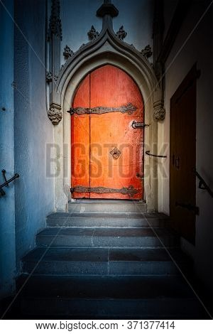 Old Church Entrance Doors In Germany, Europe. Old Architecture. Faith And Religion.