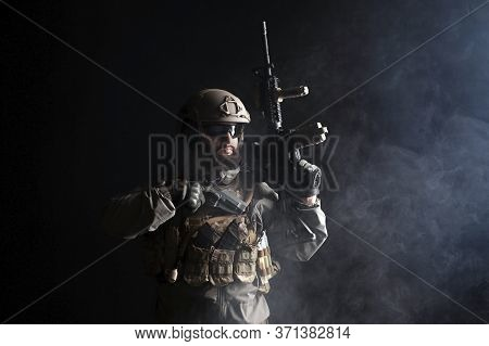 Portrait Of A Commando In Uniform With Weapons Against A Dark Background, Elite Troops