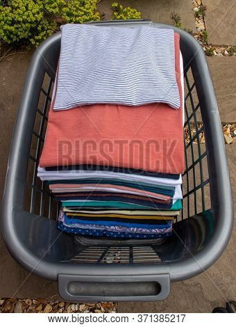Basket Of Ironed Clothing Left In The Garden For The Vulnerable Who Are Isolating