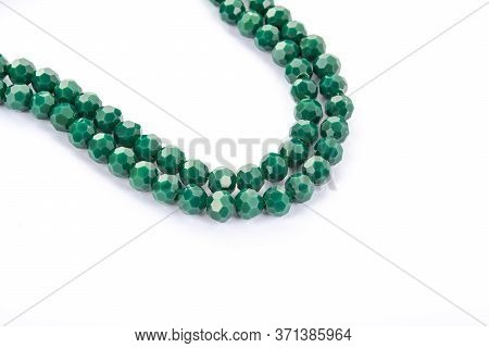 Beautiful Light Green Glass Sparkle Crystal Isoalted Beads On White Background. Use For Diy Beaded J
