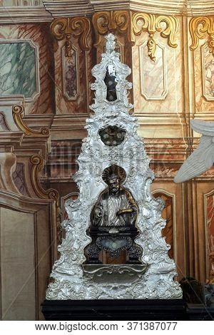 ZAGREB, CROATIA - MAY 16, 2013: The reliquary with the relics of St. Ignatius Loyola, main altar in the Church of Saint Catherine of Alexandria in Zagreb, Croatia