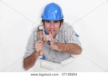 Man with hammer and nail tearing through