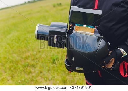 Parachute Helmet With An Installed Dslr Camera In The Hands Of A Skydiver, Cameraman And Air Photogr