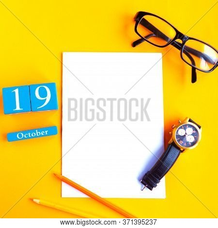October The 19th. Flat Lay Photo With Calendar, White Mockup Blank, Glasses And Watch On Bright Oran
