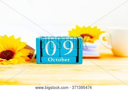 October 9 On The Wooden Calendar.the Nine Day Of The Autumn Month, A Calendar For The Workplace. Aut