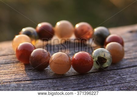 Bracelet Jewelry Made Of Different Types Of Round Gemstone Beads, Including Translucent Red, Green,