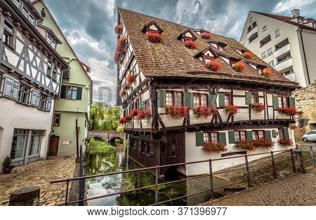 Crooked House In Ulm, Germany. It Is Landmark Of Ulm Located In Old Fisherman`s Quarter. View Of Vin
