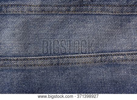 Vintage Denim Texture Background. Stitched Seam On Denim Clothing. Stylish Frayed Denim Background.