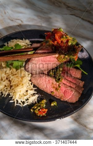 Rib-eye Steak Cooked Rare With Hot And Spicy Thai Crying Tiger Sauce Also Called Suea Rong Hai
