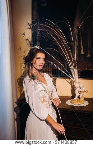 A Bride In Underwear And A White Robe In The Interior Of A Villa In Italy At A Wedding.morning Of Th