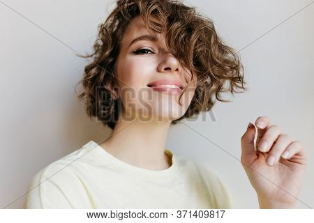 Ecstatic Laughing Girl Posing With Happy Smile On White Background. Indoor Close-up Photo Of Glad Br