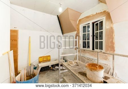 Plastering A Room, Plasterboard Drywall Installation In Home Interior With Plastering Tools, Uk Hous