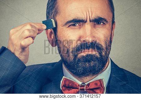 External Memory Needed Concept. Portrait Of Interested Bearded Businessman Wearing Elegant Jacket, R