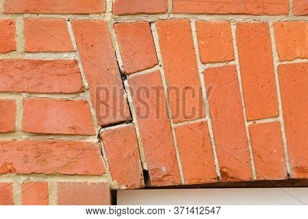 Dropping Brick Arch And Cracking Mortar In Brickwork Above A Window In A Uk House. Home Maintenance