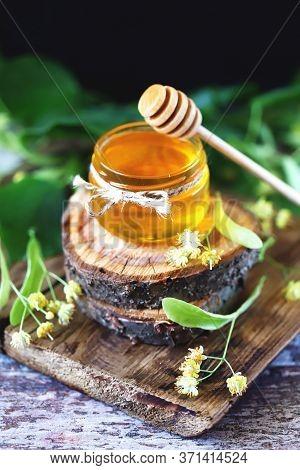 Selective Focus. Linden Honey In A Jar. Leaves And Flowers Of Linden. Freshly Linden Honey.