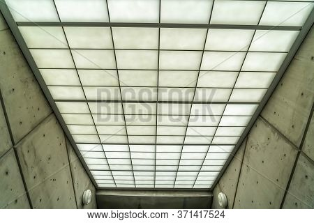 Commercial Building Interior With Slanted Roof Made Of Frosted Glass Panes