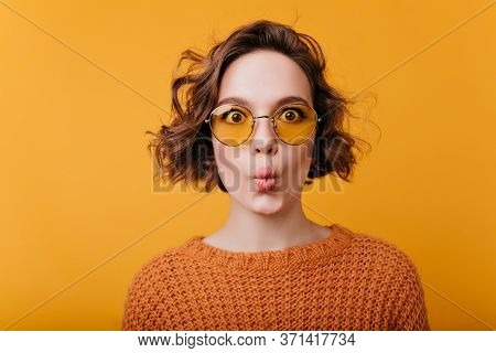 Close-up Portrait Of Pretty Girl Isolated On Yellow Background With Kissing Face Expression. Funny E