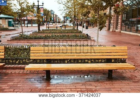 Boulder, Colorado - May 27th, 2020: Park Benches And Flowerbeds Along Pearl Street Mall, A Pedestria