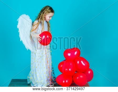 Kids Valentines Day. Looks Like An Angel. Angel Kid With Blonde Curly Hair. Cute Child Girl In White
