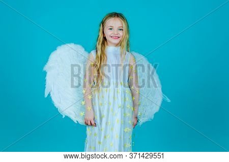 Lovely And Cute Little Girl Angel. Little Angel Girl In White Dress With Angel Wings On Isolated Bac
