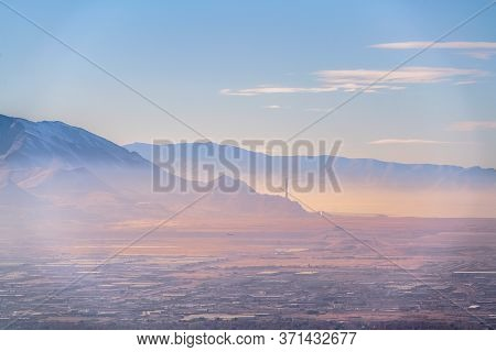 Hazy Overview Of Salt Lake City, Utah At Sunrise
