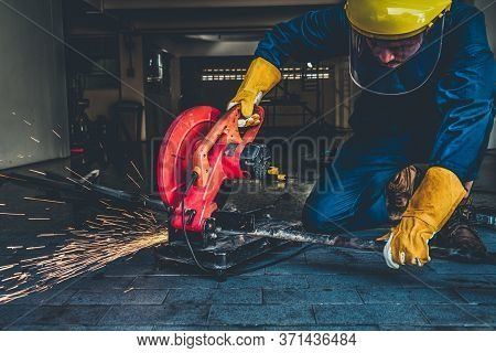 Professional Mechanic Is Cutting Steel Metal.