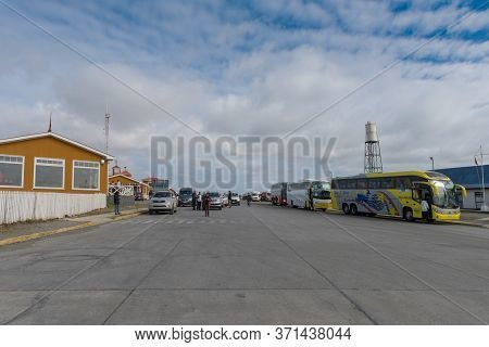 Punta Delgada, Chile-february 10, 2020: People And Vehicles Are Waiting To Board A Ferry To Cross Th