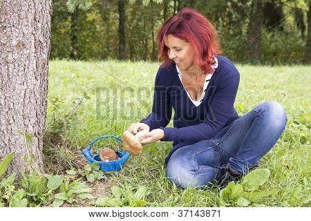Cute woman cleaning mushroom Boletus Edulis