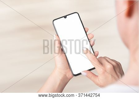 Mockup Image Of Woman's Hands Holding Modern Cell Mobile Phone With Blank Screen, Indoor